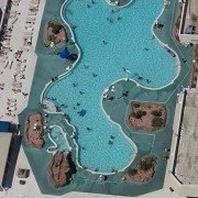An above view of a roof-top swimming pool when looking down from the top of the Stratosphere in Las Vegas, NV. (Photo credit: Wikipedia)